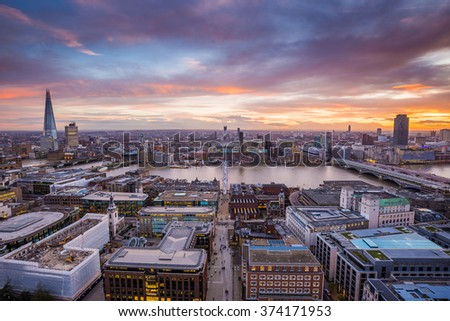 Panoramic skyline shot of south London at dusk with beautiful sunset and clouds and famous skyscrapers and landmarks - London, UK - stock photo