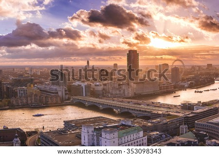 Panoramic skyline view of south and west London at sunset with river Thames and famous landmarks - London, UK - stock photo