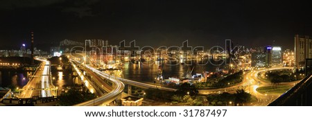 Panoramic Stitch: Cargo Terminal Of Hong Kong China In A Rainy Evening - stock photo