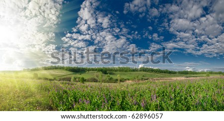 panoramic summer landscape with hills meadow and sky - stock photo