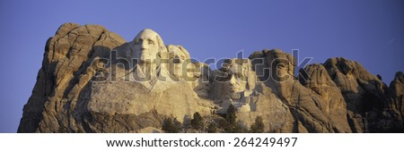 Panoramic sunrise view on Presidents George Washington, Thomas Jefferson, Teddy Roosevelt and Abraham Lincoln at Mount Rushmore National Memorial, South Dakota - stock photo