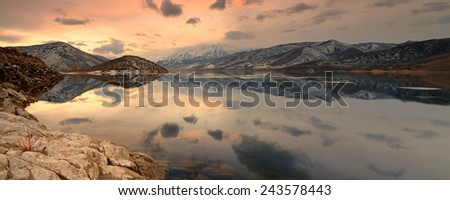 Panoramic sunset landscape at a lake in the Utah mountains, USA. - stock photo