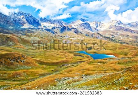 Panoramic view at the mountains and valley. Picture was taken during trekking hike in gorgeous and amazing Caucasus mountains at autumn, Arhiz region, Abishira-Ahuba range, Karachay-Cherkessia, Russia - stock photo
