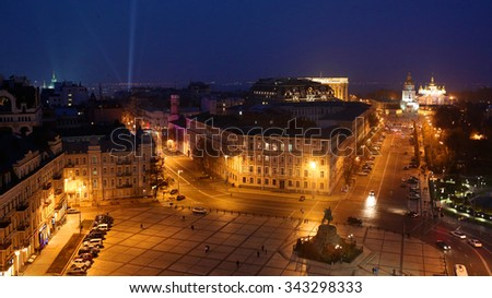 Panoramic view from Bell tower of the Saint Sophia Cathedral in Kiev, Ukraine at night. St. Michael's Golden-domed monastery, Bohdan Khmelnitskiy monument and St. Andrew's church in the background. - stock photo