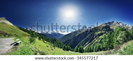 Panoramic view from mountain top. Bench at the end of hiking trail vista point - stock photo