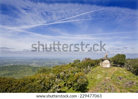 Panoramic view from the top of Alor mountain. Unrecognizable man on the top of the hill - stock photo