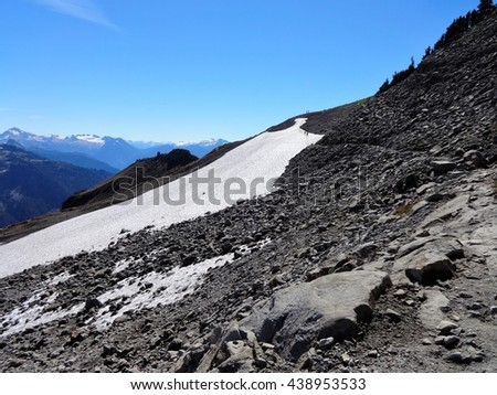 Panoramic view is waiting after the rocky trail - stock photo