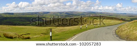 Panoramic view narrow road Welsh hills from the Mynydd Epynt, Wales UK. - stock photo