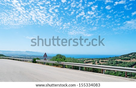 panoramic view of a country road along the coastline - stock photo