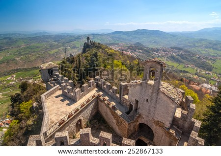Panoramic view of a old tower Montale with fortress Guaita in the foreground. - stock photo