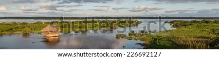 Panoramic view of a Traditional house and  the Amazon river in Iquitos, Loreto, Peru - stock photo