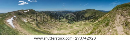 Panoramic view of amazing valley under the blue sky in the spring mountains - Svydovets range, Carpathians, West Ukraine - stock photo