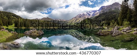 Panoramic view of an alpine lake in the Austrian Alps - stock photo