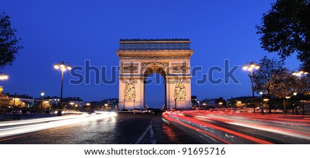 Panoramic view of Arc de Triomphe by night - stock photo