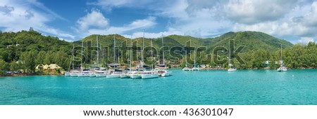 panoramic view of baie saint anne harbour in praslin island seychelles - stock photo