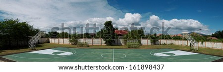 Panoramic view of basketball court - stock photo