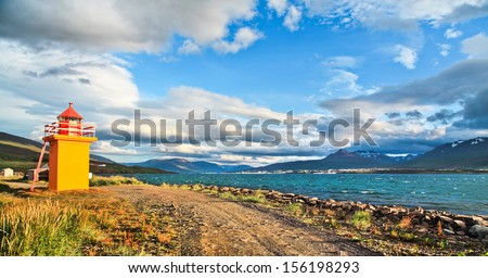 Panoramic view of beautiful landscape with lighthouse and ocean in evening light in Iceland - stock photo