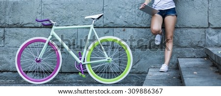 Panoramic view of bike and hipster girl  - stock photo
