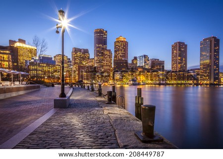 Panoramic view of Boston in Massachusetts, USA showcasing its historic architecture mixed with modern skyscrapers at sunset. - stock photo