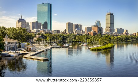 Panoramic view of Boston in Massachusetts, USA showcasing its mix of modern and historic architecture and the famous Charles River that cross the city on a hot summer day. - stock photo