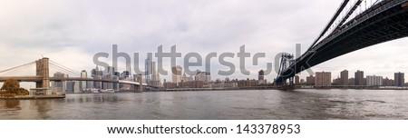 Panoramic view of Brooklyn and Manhattan Bridge in New York City. - stock photo