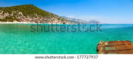 Panoramic view of Cala Luna cove at Gulf of Orosei in Sardinia - stock photo