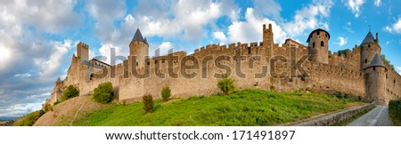 Panoramic view of Carcassonne medieval city walls at late afternoon in France - stock photo