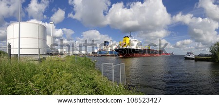 panoramic view of chemical tankers in amsterdam harbor - stock photo