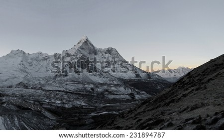 Panoramic view of circus of the Ama Dablam and Lhotse-Nuptse wall before sunrise - Everest region, Nepal - stock photo