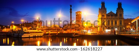 Panoramic view of Columbus Quay from Port Vell in night time. Barcelona - stock photo
