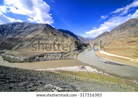 Panoramic view of confluence of Zanskar (from top) and Indus rivers near Nimmu village in Ladakh, India.   - stock photo
