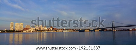 Panoramic view of Delaware River as seen from Camden New Jersey of Philadelphia, PA at sunrise - stock photo