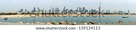 Panoramic view of Dubai from the Persian Gulf - stock photo