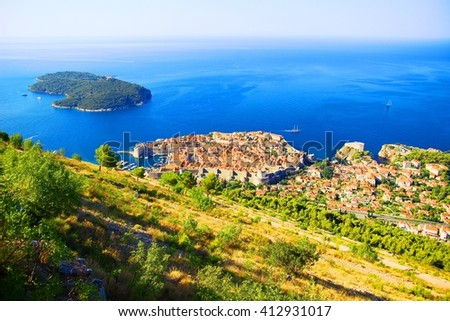 Panoramic view of Dubrovnik Old town, island Lokrum, Adriatic sea and surrounding coast  - stock photo