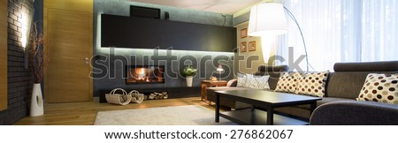 Panoramic view of elegant and modern family room - stock photo