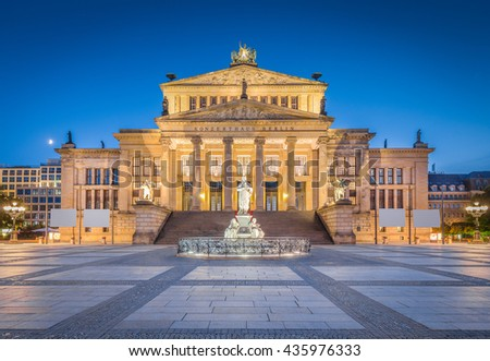 Panoramic view of famous Berlin Concert Hall at historic Gendarmenmarkt square in twilight during blue hour at dusk in summer, Berlin Mitte district, Germany - stock photo