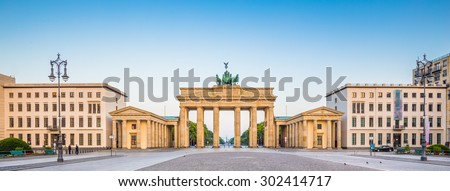 Panoramic view of famous Brandenburger Tor (Brandenburg Gate), one of the major landmarks and national symbols of Germany, in beautiful golden morning light at sunrise, Pariser Platz, Berlin, Germany - stock photo