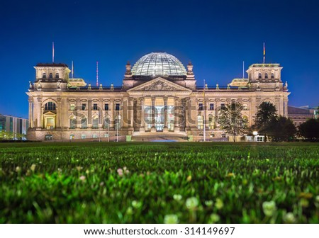 Panoramic view of famous Reichstag building, seat of the German Parliament (Deutscher Bundestag), in twilight during blue hour at dusk, Berlin, Germany - stock photo