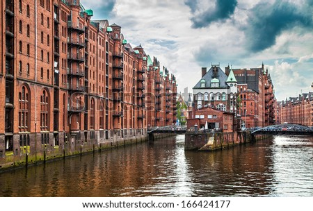 Panoramic view of famous Speicherstadt with dark clouds before the storm in Hamburg, Germany - stock photo