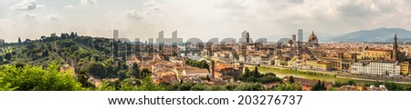 Panoramic view of Firenze from the Piazzale Michelangelo on a hot summer afternoon; Gardino di Boboli, river Arno, Ponte Vecchio, Palazzo Vecchio, Duomo, Campanile, Batistero. Florence, Italy, HDR - stock photo