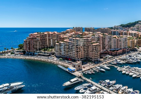 Panoramic view of Fontvieille - new district of Monaco. Boats and a high-rise apartment complex. Principality of Monaco is a sovereign city state, located on the French Riviera in Western Europe. - stock photo