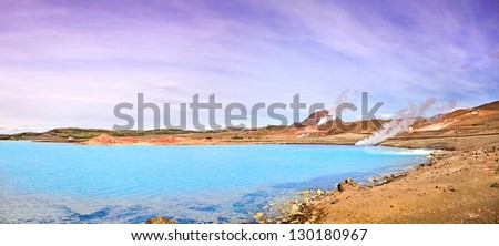 Panoramic view of geothermal landscape with beautiful azure blue crater lake, Myvatn area, north of Iceland - stock photo