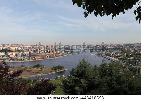 Panoramic view of Golden Horn inlet from Pierre Loti Point at sunset, Istanbul, Turkey. - stock photo