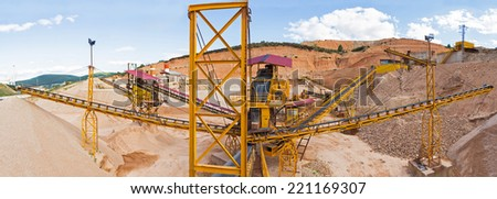 Panoramic view of gravel with ribbons distribution according to sizes in the gravel quarry outdoors - stock photo