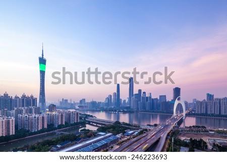 panoramic view of guangzhou skyline in nightfall - stock photo