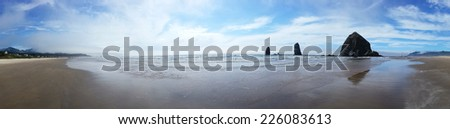 Panoramic view of Haystack Rock and Cannon Beach near Astoria, Oregon on a summer's day - stock photo