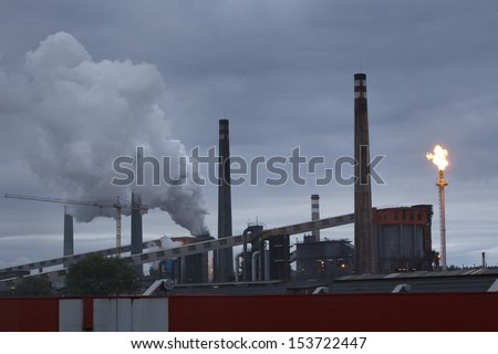 Panoramic view of heavy industry at dawn in  Asturias, North Spain.  Smokestacks in factory at dawn. - stock photo
