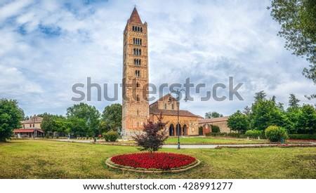 Panoramic view of historic Abbey of Pomposa, the world famous Benedictine monastery, Codigoro, Emilia-Romagna, Italy - stock photo