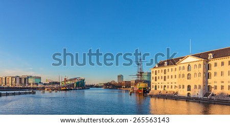 Panoramic view of historic buildings on the waterfront in Amsterdam - stock photo