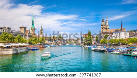 Panoramic view of historic Zurich city center with famous Fraumunster and Grossmunster Churches and river Limmat at Lake Zurich on a sunny day with clouds in summer, Canton of Zurich, Switzerland - stock photo